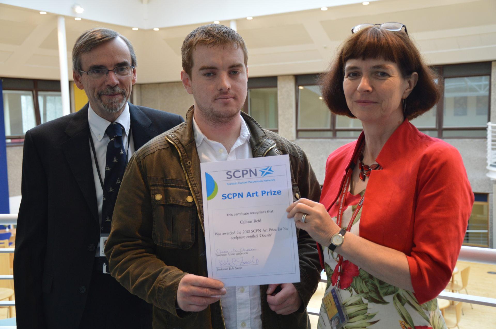 Callum accepting his award
